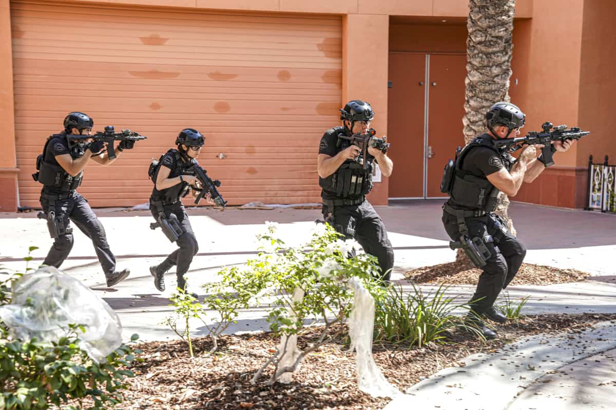 """SWAT Season 5 Episode 2 """"Madrugada"""" – Still in Mexico, Hondo teams up with a local cop for a dangerous rescue mission, only to find himself with a target on his back. Also, back in Los Angeles, Hicks considers disbanding the team for good, on the CBS Original series S.W.A.T., Friday, Oct. 8 (8:00-9:00 PM, ET/PT) on the CBS Television Network, and available to stream live and on demand on Paramount+.   Pictured (L-R): David Lim as Victor Tan, Lina Esco as Christina """"Chris"""" Alonso, Kenneth """"Kenny"""" Johnson as Dominique Luca, and Jay Harrington as David """"Deacon"""" Kay. Photo: Ron P. Jaffe/CBS ©2021 CBS Broadcasting, Inc. All Rights Reserved."""