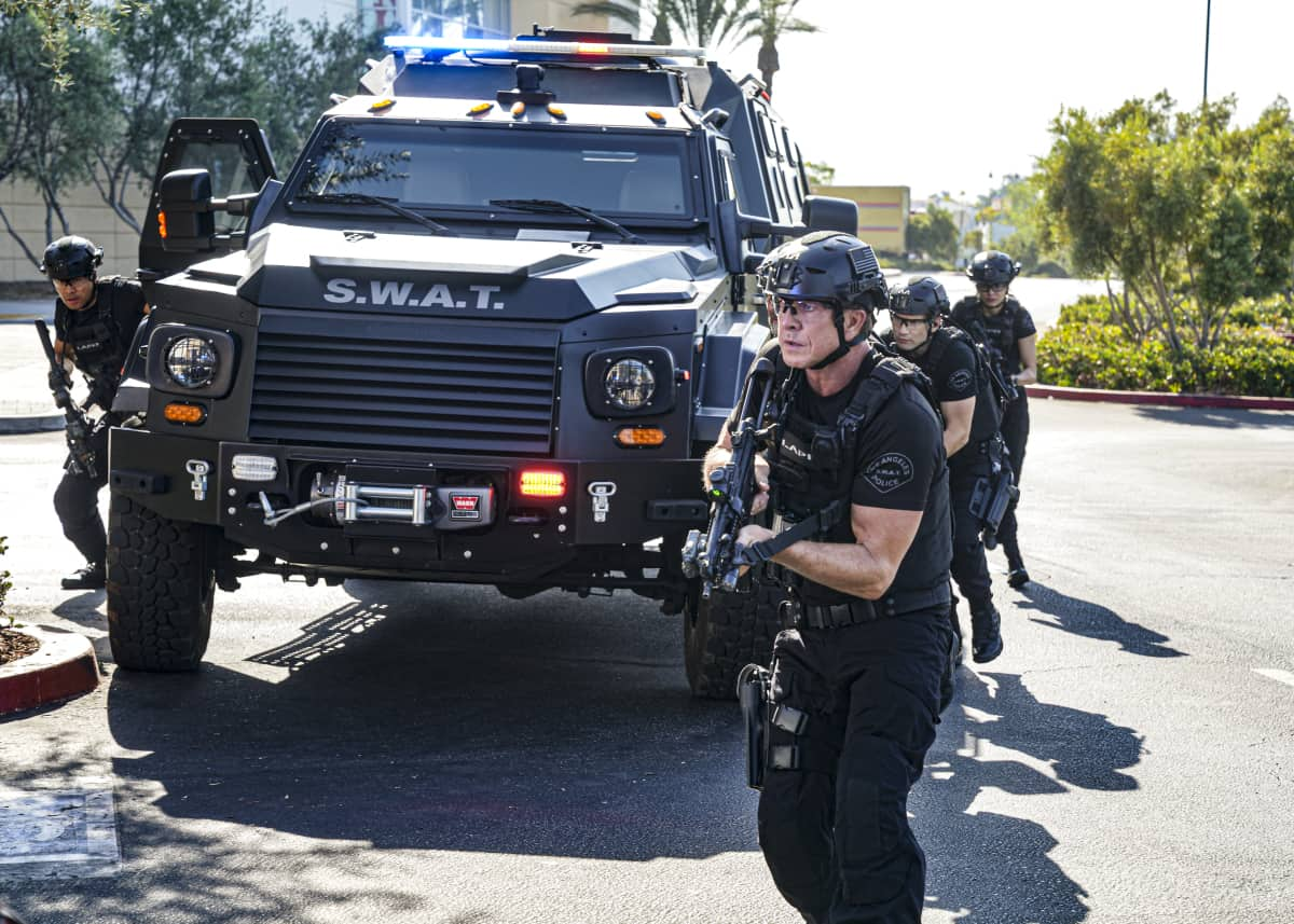 """SWAT Season 5 Episode 2 """"Madrugada"""" – Still in Mexico, Hondo teams up with a local cop for a dangerous rescue mission, only to find himself with a target on his back. Also, back in Los Angeles, Hicks considers disbanding the team for good, on the CBS Original series S.W.A.T., Friday, Oct. 8 (8:00-9:00 PM, ET/PT) on the CBS Television Network, and available to stream live and on demand on Paramount+.   Pictured (L-R): David Lim as Victor Tan, Kenneth """"Kenny"""" Johnson as Dominique Luca, Alex Russell as Jim Street, and Lina Esco as Christina """"Chris"""" Alonso. Photo: Ron P. Jaffe/CBS ©2021 CBS Broadcasting, Inc. All Rights Reserved."""