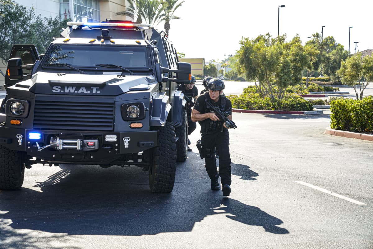 """SWAT Season 5 Episode 2 """"Madrugada"""" – Still in Mexico, Hondo teams up with a local cop for a dangerous rescue mission, only to find himself with a target on his back. Also, back in Los Angeles, Hicks considers disbanding the team for good, on the CBS Original series S.W.A.T., Friday, Oct. 8 (8:00-9:00 PM, ET/PT) on the CBS Television Network, and available to stream live and on demand on Paramount+.   Pictured (L-R): Kenneth """"Kenny"""" Johnson as Dominique Luca. Photo: Ron P. Jaffe/CBS ©2021 CBS Broadcasting, Inc. All Rights Reserved."""