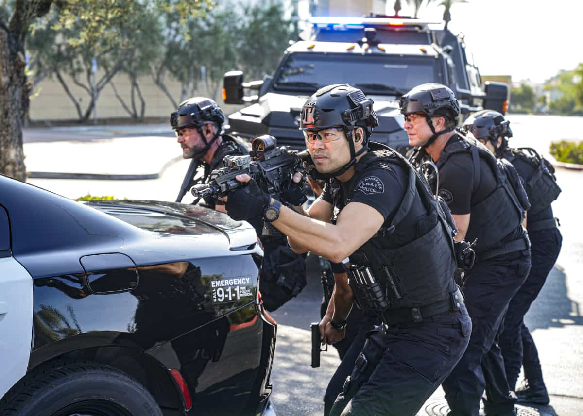 """SWAT Season 5 Episode 2 """"Madrugada"""" – Still in Mexico, Hondo teams up with a local cop for a dangerous rescue mission, only to find himself with a target on his back. Also, back in Los Angeles, Hicks considers disbanding the team for good, on the CBS Original series S.W.A.T., Friday, Oct. 8 (8:00-9:00 PM, ET/PT) on the CBS Television Network, and available to stream live and on demand on Paramount+.   Pictured (L-R): Jay Harrington as David """"Deacon"""" Kay, David Lim as Victor Tan, and Kenneth """"Kenny"""" Johnson as Dominique Luca. Photo: Ron P. Jaffe/CBS ©2021 CBS Broadcasting, Inc. All Rights Reserved."""