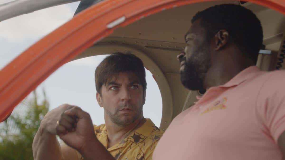 """MAGNUM P.I. Season 4 Episode 2 """"The Harder They Fall"""" While Magnum and Higgins reunite and work the case of a construction workerÕs tragic death, TC and Shammy get skyjacked by a pair of drug runners posing as tourists, on MAGNUM P.I., Friday, Oct. 8 (9:00-10:00 PM, ET/PT) on the CBS Television Network and available to stream live and on demand on Paramount+.  Pictured L-R: Christopher Thornton as Kenny 'Shammy' Shamberg and Stephen Hill as Theodore 'TC' Calvin Photo: Screen Grab/CBS ©2021 CBS Broadcasting, Inc. All Rights Reserved."""