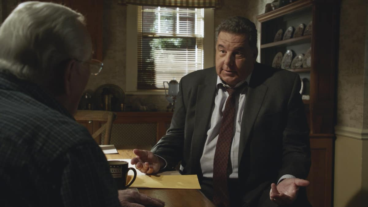 """BLUE BLOODS Season 12 Episode 2 """"Times Like These"""" -- Tension escalates between Frank and Mayor Chase (Dylan Walsh) after Frank makes a public arrest that goes viral. Also, Danny and Baez investigate a gang attack that takes an unexpected turn; Jamie worries when Eddie lies to him about where she's going in the evenings; and Anthony secretly recruits the Reagans for help with a surprise for Erin, on the CBS Original series BLUE BLOODS, Friday, Oct. 8 (10:00-11:00 PM, ET/PT) on the CBS Television Network, and available to stream live and on demand on Paramount+. Dylan Walsh guest stars as Mayor Peter Chase. Pictured: Len Cariou as Henry Reagan, Steven Schirripa as Anthony Abetamarco. Photo: Best Possible Screengrab ©2021 CBS Broadcasting Inc. All Rights Reserved."""