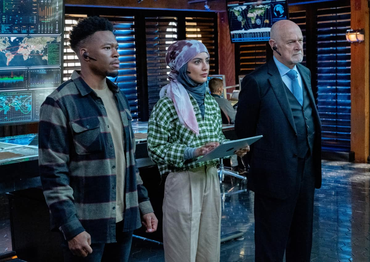 """NCIS LOS ANGELES Season 13 Episode 1 """"Subject 17"""" - Pictured: Caleb Castille (Special Agent Devin Rountree). Medalion Rahimi (Special Agent Fatima Namazi) and Gerald McRaney (Retired Admiral Hollace Kilbride). While Callen suspects Hetty of keeping secrets about his past and Joelle surfaces in her quest to capture Katya, NCIS must track down an informant whose life is in danger.  Also, Kensi and Deeks work to expand their family, on the 13th season premiere of NCIS: LOS ANGELES, Sunday, Oct. 10 (9:00-10:00 PM, ET/PT) on the CBS Television Network and available to stream live and on demand on the CBS app and Paramount+. Robert Voets/CBS ©2021 CBS Broadcasting, Inc. All Rights Reserved."""