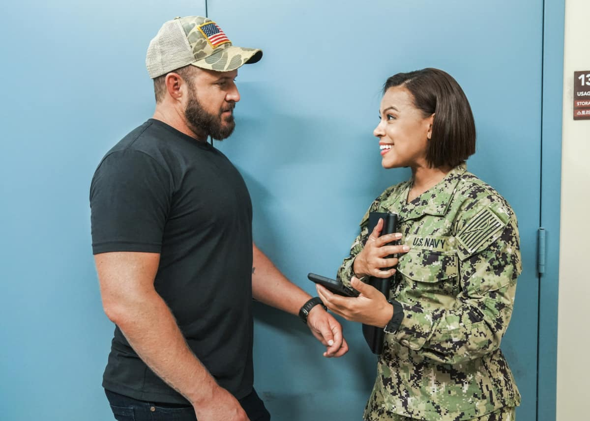 """SEAL TEAM Season 5 Episode 1 """"Trust, But Verify: Part 1"""" – Everyone on Bravo is shocked when they learn a training exercise is really cover for a covert mission to get a weapons expert out of one of the most dangerous countries in the world, on the fifth season premiere of SEAL TEAM, Sunday, Oct. 10 (10:00-11:00 PM, ET/PT) on the CBS Television Network, and available to stream live and on demand on Paramount+. Pictured L to R: AJ Buckley as Sonny Quinn and Toni Trucks as Lisa Davis. Photo: Ron P. Jaffe/CBS ©2021 CBS Broadcasting, Inc. All Rights Reserved."""