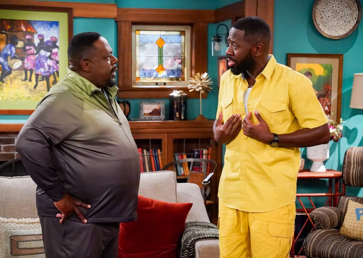 """THE NEIGHBORHOOD Season 4 Episode 4 """"Welcome to the Porch Pirate"""" - Pictured: Cedric the Entertainer (Calvin Butler) and Sheaun McKinney (Malcolm Butler). When Dave and Gemma face a devastating loss, Calvin and Tina offer emotional support and reflect on a period that tested their own family, on the CBS Original series THE NEIGHBORHOOD, Monday, Oct. 11 (8:00-8:30 PM, ET/PT) on the CBS Television Network, and available to stream live and on demand on Paramount+. Photo: Monty Brinton/CBS ©2021 CBS Broadcasting, Inc. All Rights Reserved."""