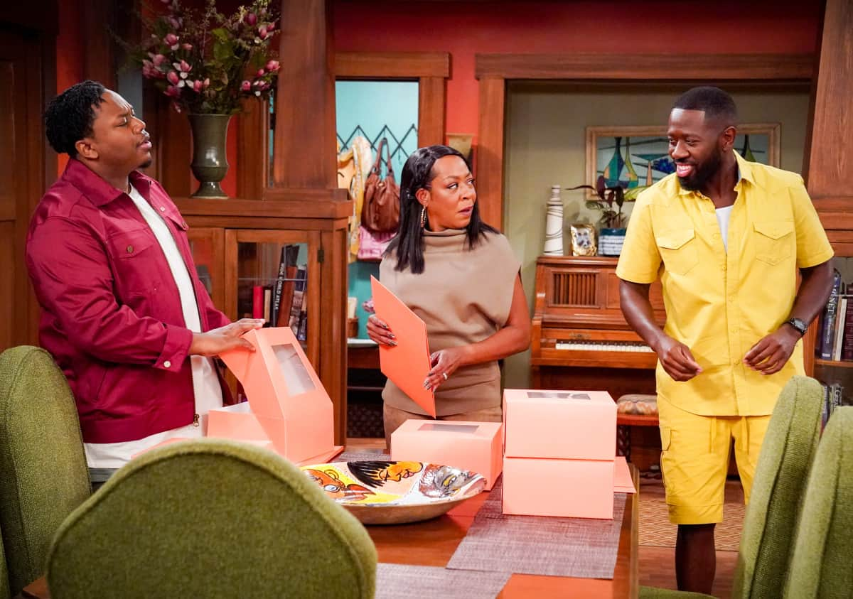 """THE NEIGHBORHOOD Season 4 Episode 4 """"Welcome to the Porch Pirate"""" - Pictured: Marcel Spears (Marty Butler), Tichina Arnold (Tina Butler) and Sheaun McKinney (Malcolm Butler). When Dave and Gemma face a devastating loss, Calvin and Tina offer emotional support and reflect on a period that tested their own family, on the CBS Original series THE NEIGHBORHOOD, Monday, Oct. 11 (8:00-8:30 PM, ET/PT) on the CBS Television Network, and available to stream live and on demand on Paramount+. Photo: Monty Brinton/CBS ©2021 CBS Broadcasting, Inc. All Rights Reserved."""