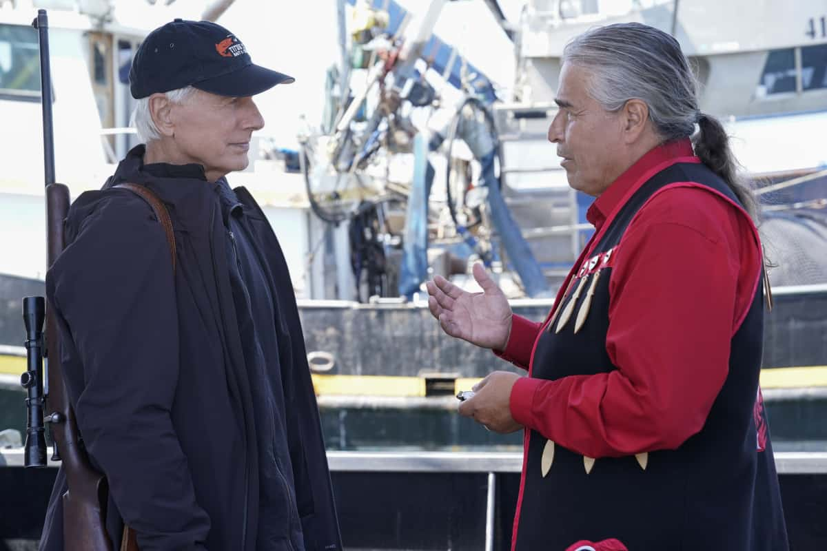 """NCIS Season 19 Episode 4 """"Great Wide Open"""" – Gibbs and McGee head to Alaska while the team works at home to uncover the conspiracy behind the serial killer, on the CBS Original series NCIS, Monday, Oct. 11 (9:00-10:00 PM, ET/PT) on the CBS Television Network and available to stream live and on demand on Paramount+. Pictured:  Mark Harmon as NCIS Special Agent Leroy Jethro Gibbs, Wayne Charles Baker as Tunu Alonak.  Photo: Cliff Lipson/CBS ©2021 CBS Broadcasting, Inc. All Rights Reserved."""