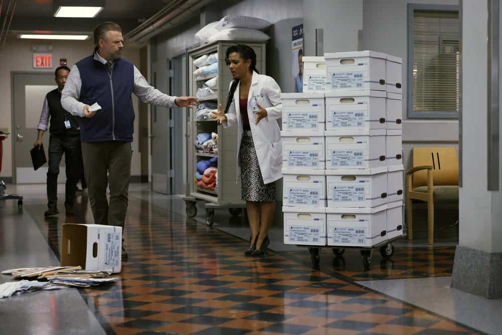 """NEW AMSTERDAM Season 4 Episode 4 -- """"Seed Money"""" Episode 404 -- Pictured: (l-r) Tyler Labine as Dr. Iggy Frome, Freema Agyeman as Dr. Helen Sharpe -- (Photo by: Will Hart/NBC)"""