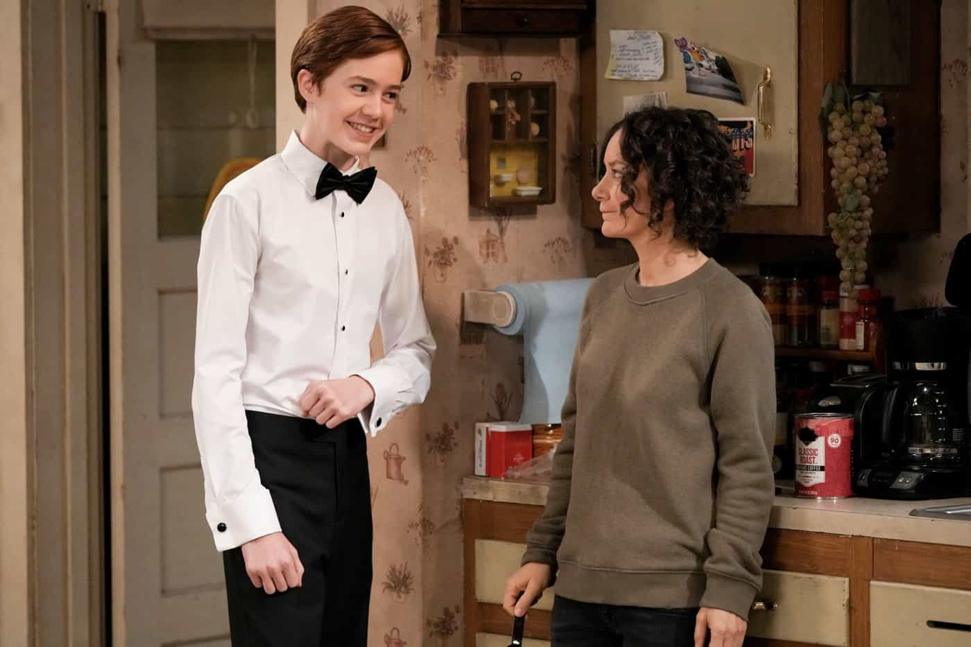 """THE CONNERS Season 4 Episode 4 - """"The Wedding of Dan and Louise"""" - It's Dan and Louise's wedding day, but it's a far-from-perfect walk down the aisle, especially when a weather report forecasts that a tornado is headed for Lanford creating chaos and surprises on """"The Conners,"""" WEDNESDAY, OCT. 13 (9:00-9:31 p.m. EDT), on ABC. (ABC/Scott Everett White) AMES MCNAMARA, SARA GILBERT"""