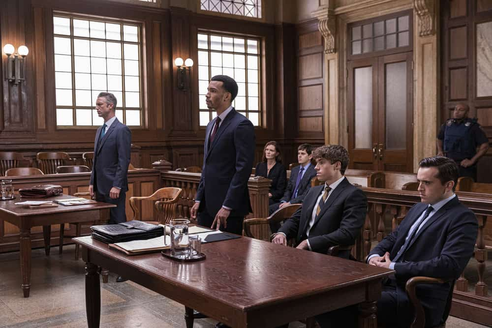 """LAW AND ORDER SVU Season 23 Episode 5 -- """"Fast Times @TheWheelHouse"""" Episode 23005 -- Pictured: (l-r) Peter Scanavino as Assistant District Attorney Sonny Carisi, Julian Elijah Martinez as Counselor Swope, Kaili Vernoff as Counselor Albert, Taylor Trensch as Diggy Wheeler, Jakob Winter as Tate Rivers, Conor Sweeney as Liam Rivers -- (Photo by: Eric Liebowitz/NBC)"""